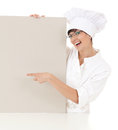 Woman chef showing blank sign white background Stock Photos
