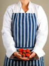 Woman chef with strawberries Royalty Free Stock Images