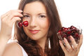 Woman with cherries Stock Image