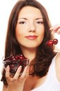 Woman with cherries happy this image has attached release Stock Photo