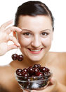 Woman with cherries over white Stock Image