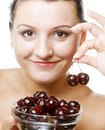 Woman with cherries over white Royalty Free Stock Images