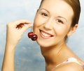 Woman with cherries young happy Royalty Free Stock Photography