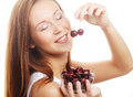 Woman with cherry isolated on white background Royalty Free Stock Photo