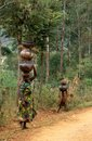 A woman and child carrying pots, Burundi Royalty Free Stock Images