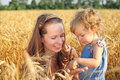 Woman with child in field Royalty Free Stock Image