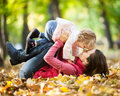 Woman with child having fun in autumn Royalty Free Stock Photography