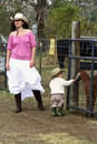 Woman and Child at the Petting Farm Royalty Free Stock Images