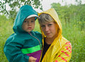 The woman with the child in the rain Stock Photography