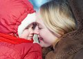 Woman and child in winter tender young women mother with little daughter Royalty Free Stock Photography