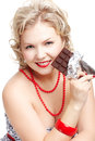 Woman with chocolate bar Royalty Free Stock Photography