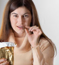 Woman with with a chocolate bar Stock Photos
