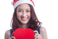 Woman with chocolate box beautiful a christmas hat and carrying a the shape of a heart Royalty Free Stock Photography