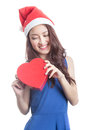 Woman with chocolate box beautiful a christmas hat and carrying a the shape of a heart Stock Photos