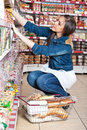 Woman choose food in supermarket Stock Photos