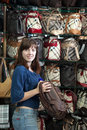 Woman chooses bag at  shop Royalty Free Stock Images