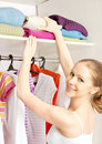 Woman chooses clothes in the wardrobe closet at home young Stock Photography