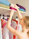 Woman chooses clothes in the wardrobe closet at home young Royalty Free Stock Image