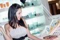 Woman chooses perfume Stock Photo