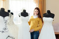 Woman chooses  wedding dress Royalty Free Stock Photo