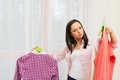 Woman choosing clothes in home interior young brunette Royalty Free Stock Images