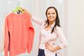 Woman choosing clothes at home young cheerful brunette in interior Royalty Free Stock Photo