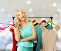 Woman choosing clothes in a shopping mall smiling blond on rack Stock Image