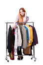 The woman choosing clothing in shop isolated on white Royalty Free Stock Photo