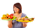 Woman choosing between fruit and hamburger isolated Stock Photos