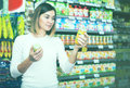 Woman choosing healthy baby food Royalty Free Stock Photo