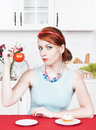 Woman choosing between healthy food and cake beautiful Stock Photography