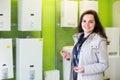 Woman choosing heating water converter joyful young brunette in hypermarket Stock Image