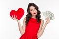 Woman choosing between love or money Royalty Free Stock Photo