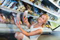 Woman choosing meat in refrigerated section in food store Royalty Free Stock Photo