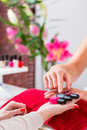 Woman choosing nail polish in beauty parlor Royalty Free Stock Photo