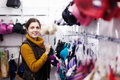 Woman choosing underwear at store clothing Stock Photography