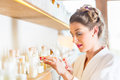 Woman choosing wellness spa products Royalty Free Stock Photo