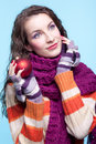 Woman with christmas ball young pretty in winter dress on blue background in hands Royalty Free Stock Photo