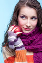 Woman with christmas ball young pretty in winter dress on blue background in hands Stock Image