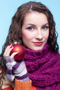Woman with christmas ball young pretty in winter dress on blue background in hands Stock Photos