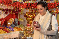 Woman at christmas decoration shop with balls holding boxes of xmas Stock Image