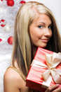 Woman on christmas with a gift Stock Photography