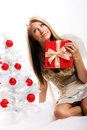 Woman on christmas with a gift Stock Photo
