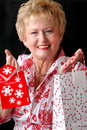 Woman with christmas gift bags Stock Photos
