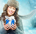 Woman with christmas gift box beautiful young surprised girl Stock Photography