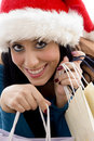 Woman with christmas hat and shopping bags Royalty Free Stock Images
