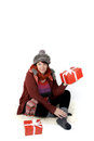 Woman with christmas presents in winter clothes and Royalty Free Stock Photo