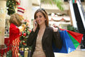 Woman Christmas Shopping Stock Photos