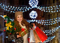 Woman with christmas tree gift and shopping bags in venice this is crushing on fashion forward stylishly dressed young holding Stock Images
