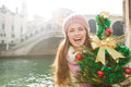 Woman with Christmas tree near Rialto Bridge in Venice, Italy Royalty Free Stock Photo